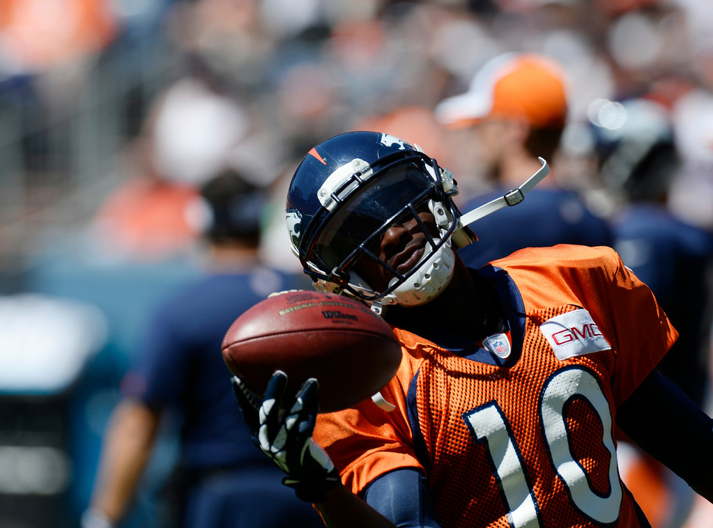 . Denver Broncos WR, Emmanuel Sanders, makes a one-handed catch during catching drills at Sports Authority Field at Mile High Saturday afternoon, August 02, 2014. (Photo By Andy Cross / The Denver Post)