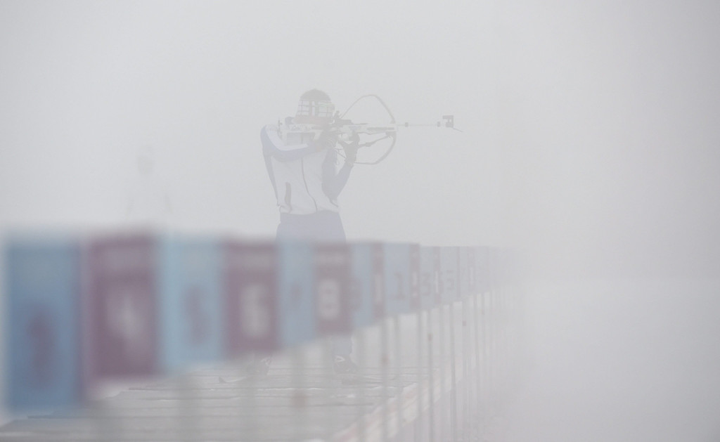 . An athlete stands at the shooting range in heavy fog prior to the Biathlon Men\'s 15km Mass Start competition at Laura Cross Country and Biathlon Center at the Sochi 2014 Olympic Games, Krasnaya Polyana, Russia, 16 February 2014.  EPA/ROLAND SCHLAGER