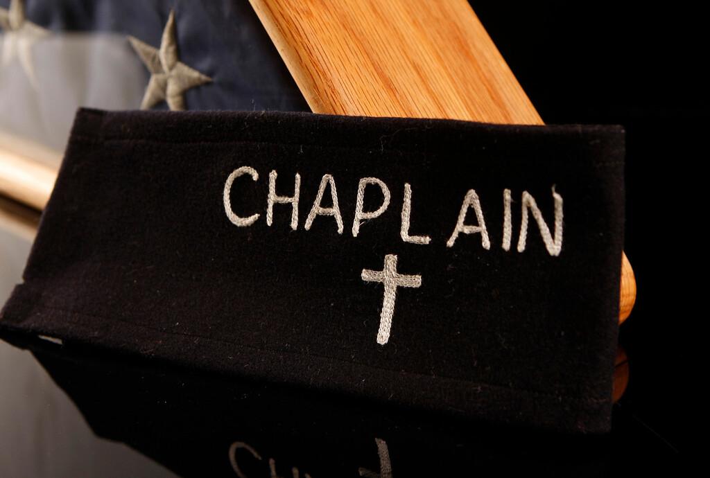 . The Chaplain\'s arm band is on display at Kapaun Mount Carmel High School in Wichita, Kansas. (Bo Rader/Wichita Eagle/MCT)