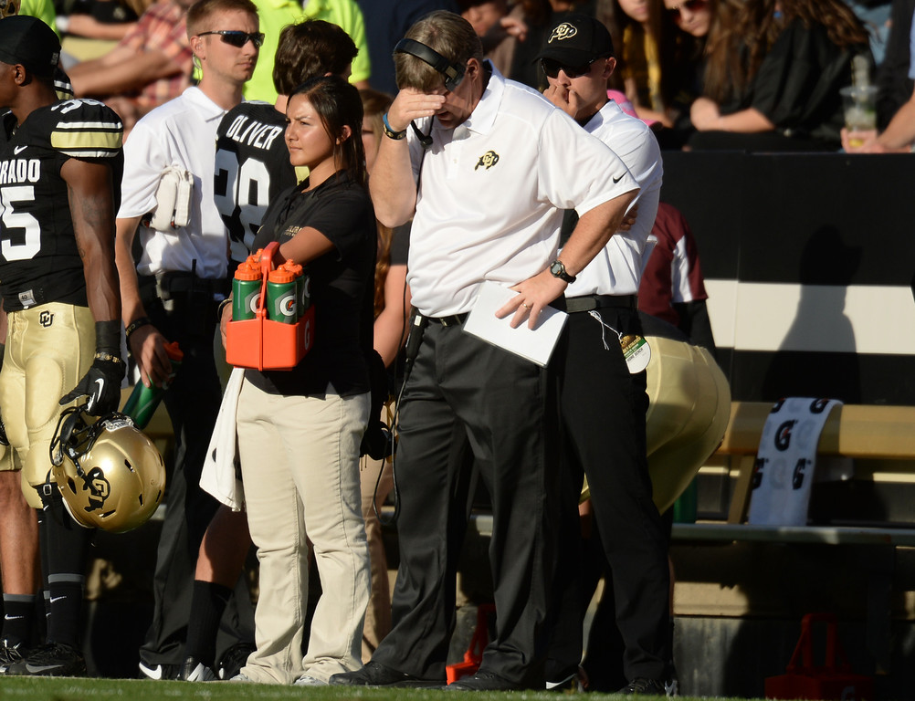 . Head coach Mike Macintyre of University of Colorado holds his head in the 2nd quarter of the game against University of Oregon at Folsom Field. Boulder, Colorado. October 5, 2013. Oregon won 57-16. (Photo by Hyoung Chang/The Denver Post)