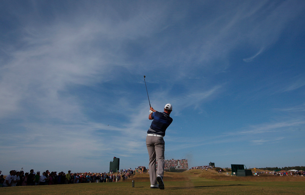 . Henrik Stenson of Sweden plays a shot off the 16th tee during the third round of the British Open Golf Championship at Muirfield, Scotland, Saturday July 20, 2013. (AP Photo/Jon Super)