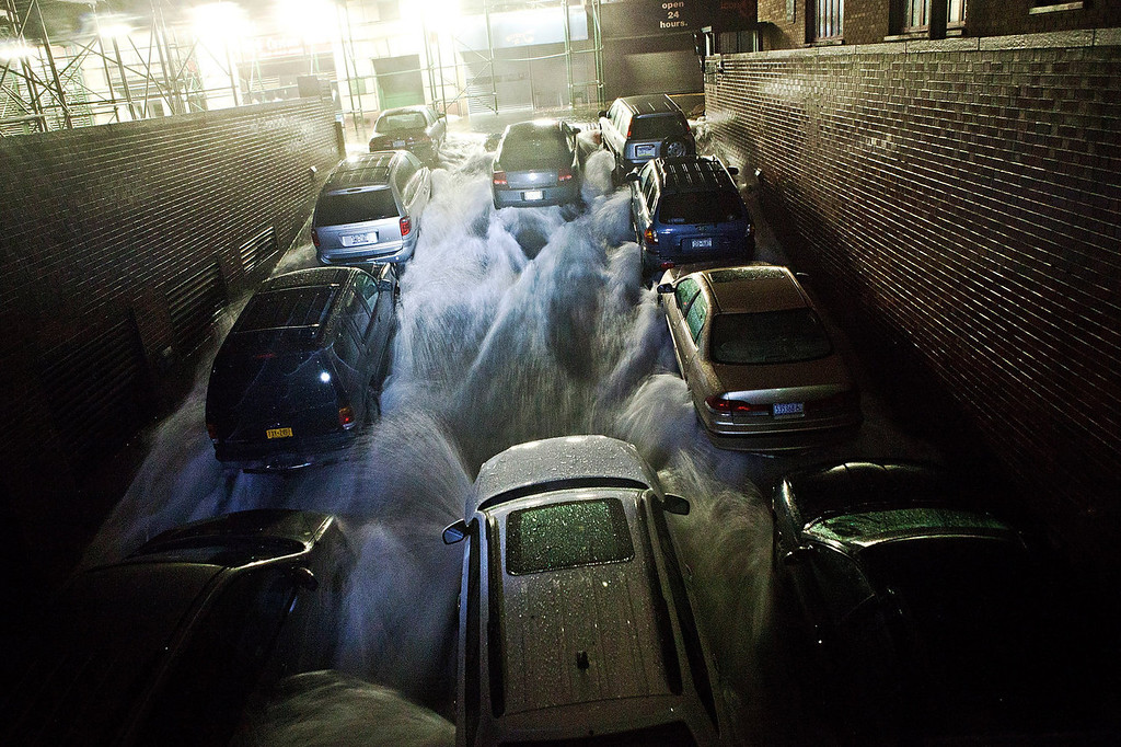 . Rising water, caused by Hurricane Sandy, rushes into an underground parking garage on October 29, 2012, in the Financial District of New York, United States. Hurricane Sandy, which threatens 50 million people in the eastern third of the U.S., is expected to bring days of rain, high winds and possibly heavy snow. New York Governor Andrew Cuomo announced the closure of all New York City will bus, subway and commuter rail service as of Sunday evening.  (Photo by Andrew Burton/Getty Images)