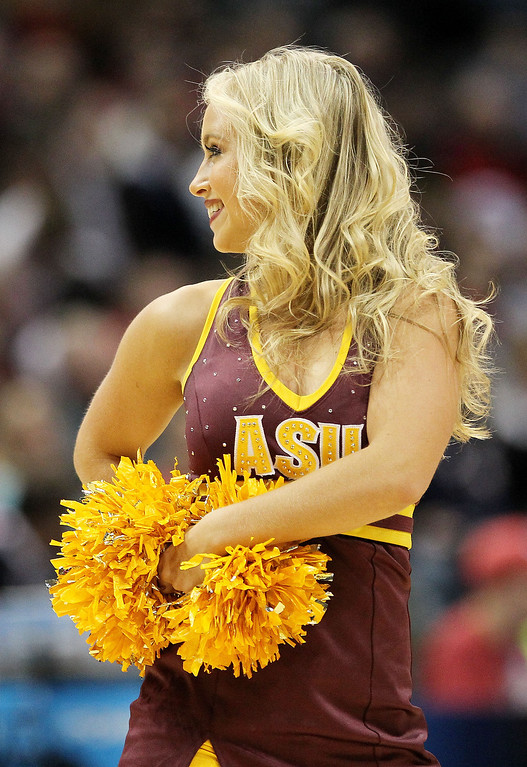 . An Arizona State Sun Devils cheerleader performs in the first half against the Texas Longhorns during the second round of the 2014 NCAA Men\'s Basketball Tournament at BMO Harris Bradley Center on March 20, 2014 in Milwaukee, Wisconsin.  (Photo by Mike McGinnis/Getty Images)