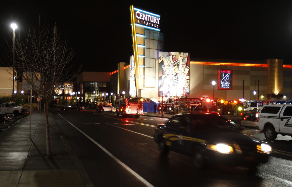 . An Oregon State police car leaves the parking lot where a gunman opened fire at the Clackamas Town Center shopping mall earlier in Portland, Ore., Tuesday, Dec. 11, 2012.  Police say three people are dead, including the gunman. (AP Photo/Don Ryan)
