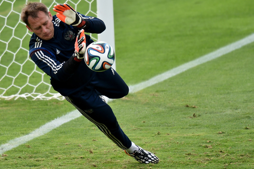 . Russia\'s goalkeeper Sergey Ryzhikov makes a save as he takes part in a training session at Estadio Novelli Junior in Itu on the outskirts of Sao Paulo on June 10, 2014, ahead of the 2014 FIFA World Cup. AFP PHOTO/KIRILL  KUDRYAVTSEV/AFP/Getty Images
