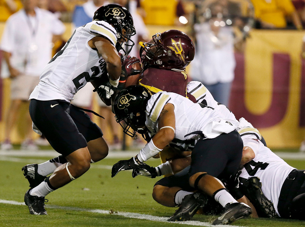 . Arizona State\'s Marion Grice scores a touchdown as he takes Colorado\'s Greg Henderson, left, Jered Bell, second from right, and Addison Gillam, right, into the end zone during the first half of an NCAA college football game on Saturday Oct. 12, 2013, in Tempe, Ariz. (AP Photo/Ross D. Franklin)