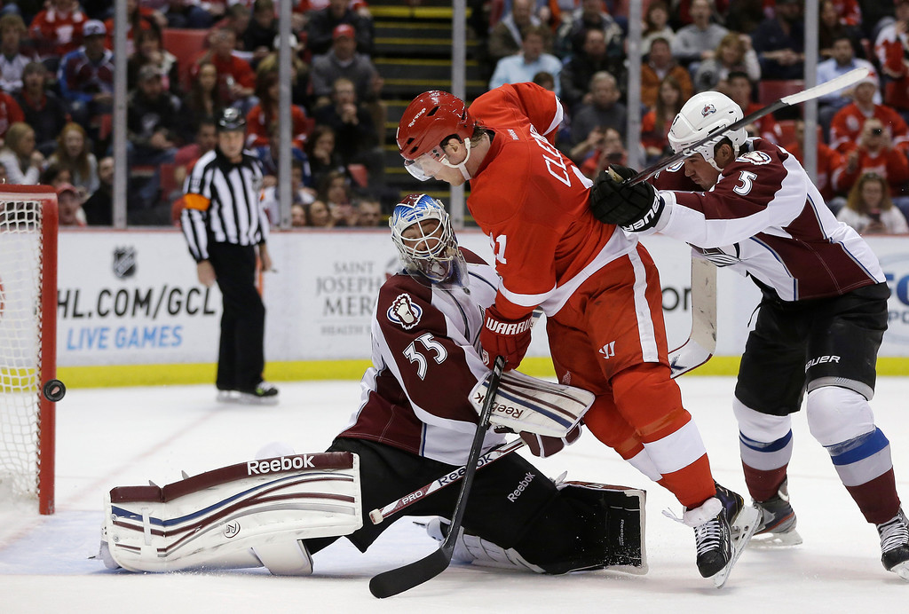 . Detroit Red Wings right wing Daniel Cleary (11) rushes the net as the puck bounces off Colorado Avalanche goalie Jean-Sebastien Giguere\'s pad for a goal by Red Wings defenseman Niklas Kronwall during the second period of an NHL hockey game in Detroit, Tuesday, March 5, 2013. At right is Avalanche defenseman Shane O\'Brien. (AP Photo/Carlos Osorio)