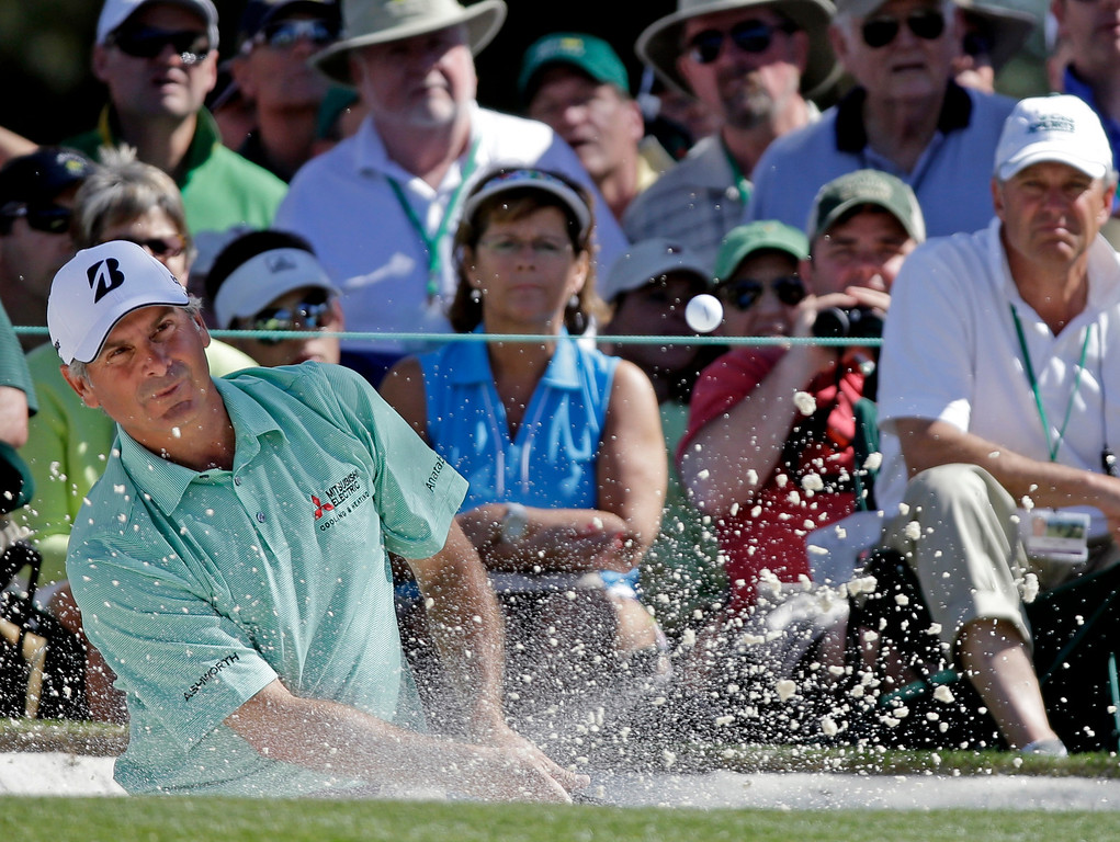 . Fred Couples watches his shot out of a bunker on the seventh green during the third round of the Masters golf tournament Saturday, April 13, 2013, in Augusta, Ga. (AP Photo/David J. Phillip)