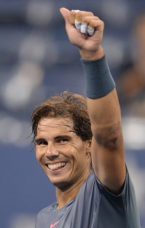 . Spanish tennis player Rafael Nadal celebrates winning against Brazil\'s Rogerio Dutra Silva during their 2013 US Open men\'s singles match at the USTA Billie Jean King National Tennis Center in New York on August 29, 2013. EMMANUEL DUNAND/AFP/Getty Images
