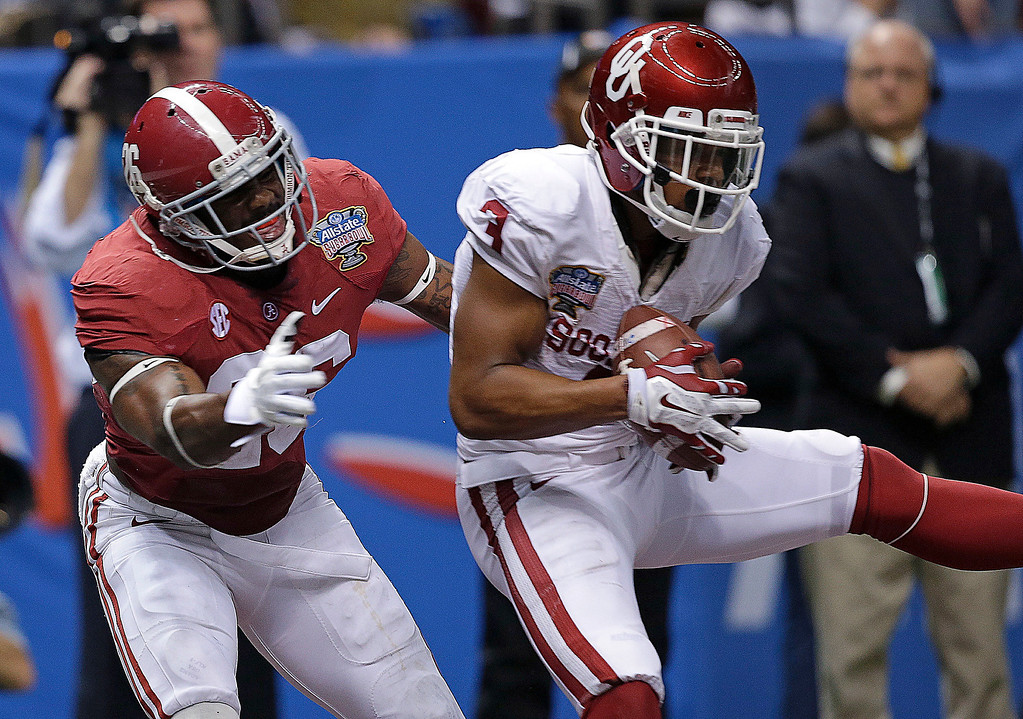 . Oklahoma wide receiver Sterling Shepard (3) pulls in a touchdown reception in front of Alabama defensive back Landon Collins (26) during the second half of the NCAA college football Sugar Bowl in New Orleans, Thursday, Jan. 2, 2014. (AP Photo/Patrick Semansky)