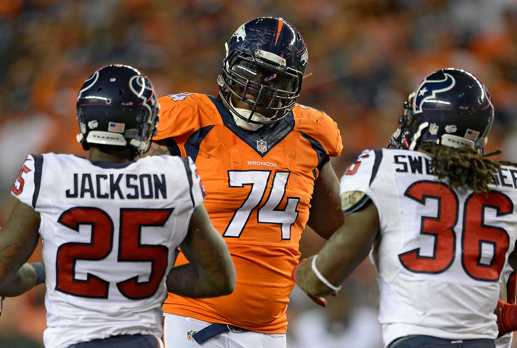 . DENVER, CO - AUGUST 23: Denver Broncos tackle Orlando Franklin (74) has a few choice words with Houston Texans strong safety D.J. Swearinger (36) after he was called for a holding call during the second quarto August 23, 2014 at Sports Authority Field at Mile High Stadium. Houston Texans cornerback Kareem Jackson (25) listens in. (Photo by John Leyba/The Denver Post)