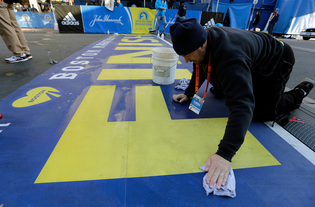 . Anthony Bisenti cleans the finish line before the running of the 118th Boston Marathon Monday, April 21, 2014 in Boston. (AP Photo/Robert F. Bukaty)