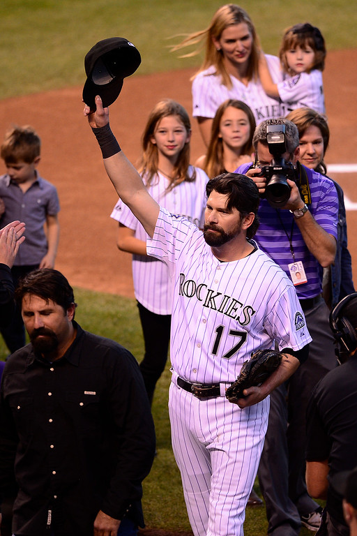 . Todd Helton tips his cap to the crowd before the start of action in Denver. The Colorado Rockies hosted the Boston Red Sox and said farewell to longtime first baseman Todd Helton, who recently announced his retirement following this season. (Photo by AAron Ontiveroz/The Denver Post)