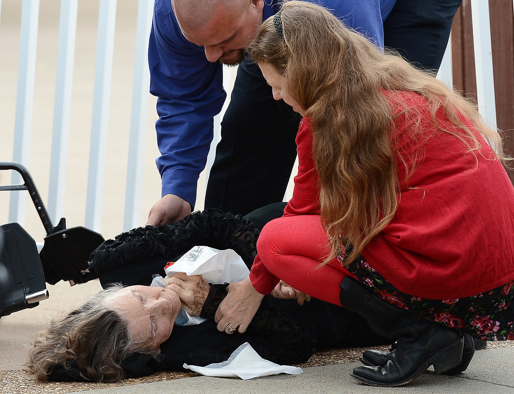 . Medical personnel attend to a woman who fainted while waiting to enter the Grand Ole Opry House for the funeral of country music star George Jones on Thursday, May 2, 2013, in Nashville, Tenn.   (AP Photo/Mark Zaleski)
