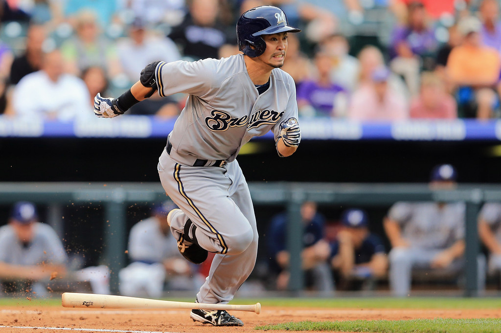 . DENVER, CO - JULY 27:  Norichika Aoki #7 of the Milwaukee Brewers bunts for a base hit against the Colorado Rockies at Coors Field on July 27, 2013 in Denver, Colorado.  (Photo by Doug Pensinger/Getty Images)