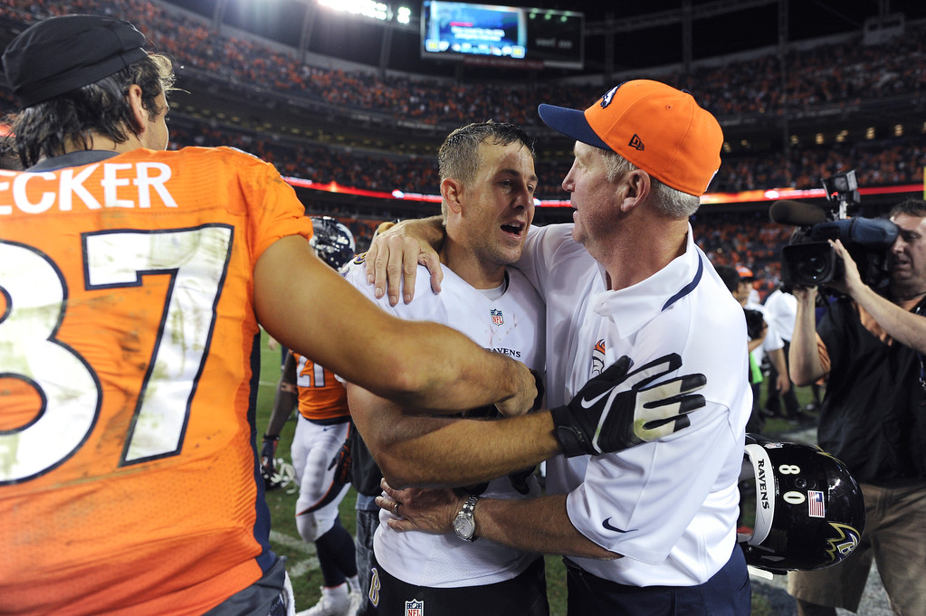 . DENVER, CO - SEPTEMBER 05: Denver Broncos head coach John Fox hugs Baltimore Ravens wide receiver Brandon Stokley (80) after the Broncos defeated the Ravens 49-24. Denver Broncos Baltimore Ravens September 5, 2013 at Sports Authority at Mile High. (Photo by Joe Amon/The Denver Post)