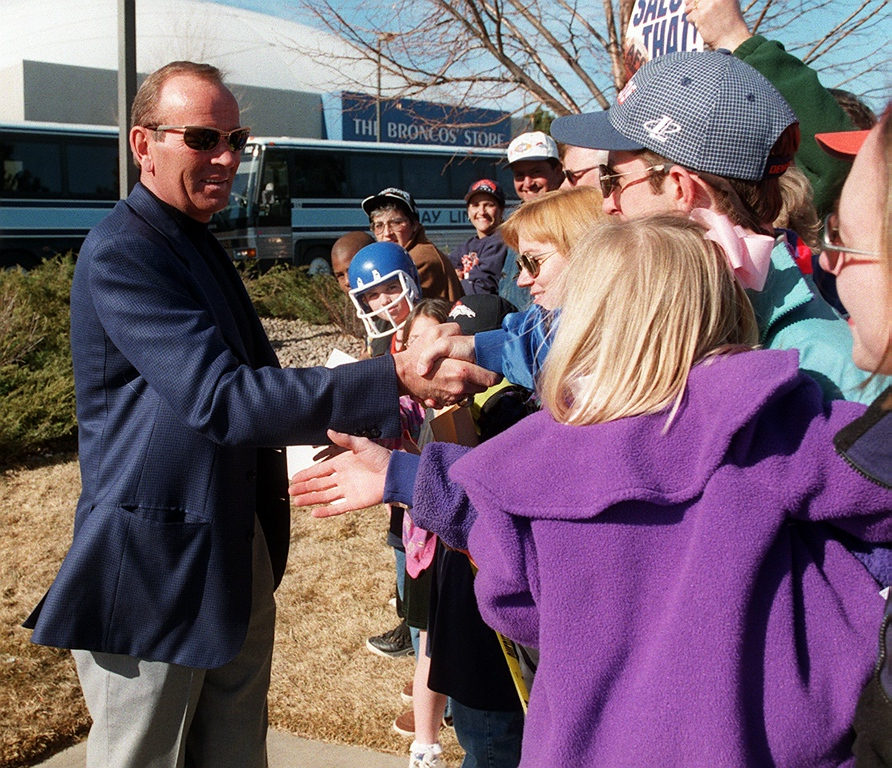 . Broncos owner Pat Bowlen greets fans moments before  leaving the Broncos Training facilities at Dove Valley headed for  San Diego. Andy Cross, The Denver Post
