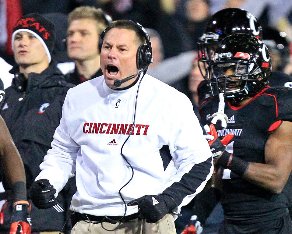 . Cincinnati coach Butch Jones cheers on his team after a touchdown in the second half of the team\'s 27-10 win over South Florida in an NCAA college football game, Friday, Nov. 23, 2012, in Cincinnati. (AP Photo/Al Behrman)