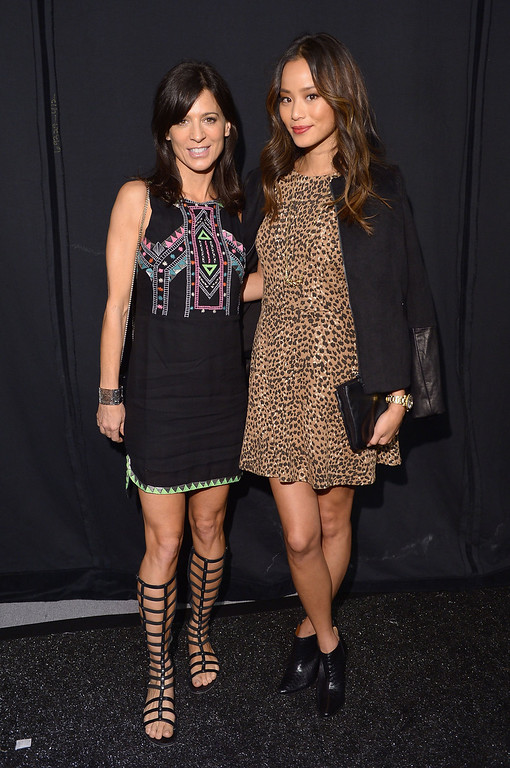 . Actresses Perrey Reeves (L) and Jamie Chung pose backstage at the Mara Hoffman fashion show during Mercedes-Benz Fashion Week Spring 2014 at The Stage at Lincoln Center on September 7, 2013 in New York City.  (Photo by Michael Loccisano/Getty Images for Mercedes-Benz Fashion Week Spring 2014)