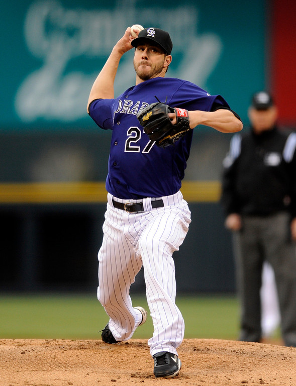 . Colorado Rockies starting pitcher Jon Garland throws against the Tampa Bay Rays during the first inning of a baseball game Saturday, May 4, 2013, in Denver. (AP Photo/Jack Dempsey)