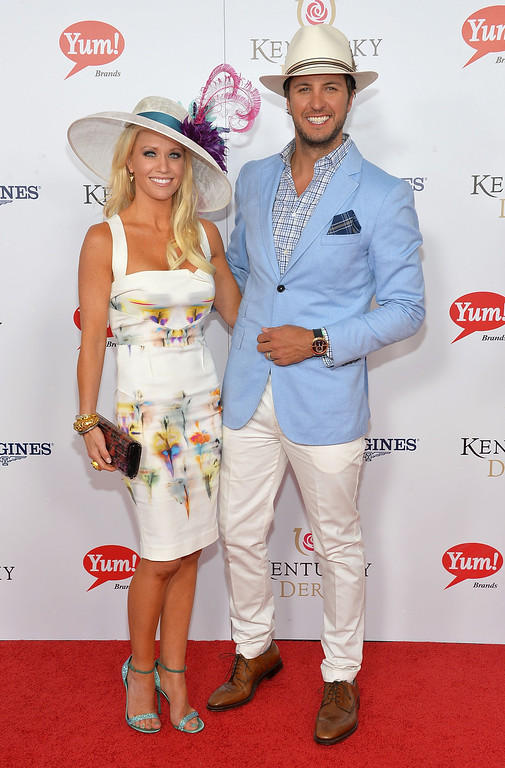 . LOUISVILLE, KY - MAY 04:   Singer Luke Bryan (R) and wife Caroline Boyer celebrate the 139th Kentucky Derby with Moet & Chandon at Churchill Downs on May 4, 2013 in Louisville, Kentucky.  (Photo by Mike Coppola/Getty Images for Moet & Chandon)