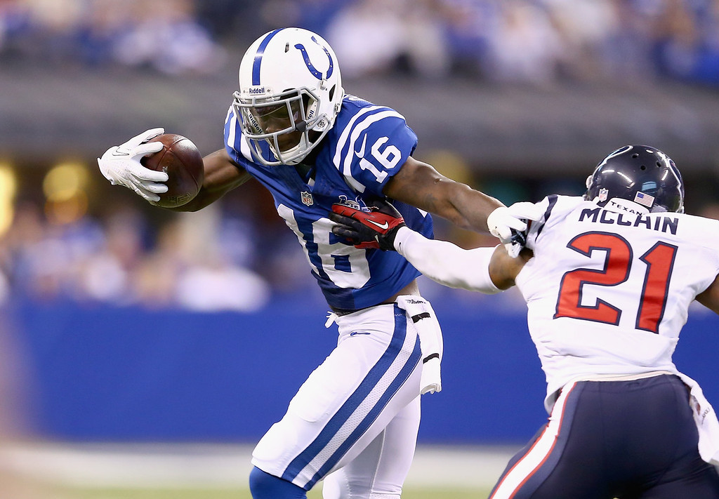 . Da\'Rick Rogers #16 of the Indianapolis Colts runs with the ball while defended by Brice McCain #21 of the Houston Texans at Lucas Oil Stadium on December 15, 2013 in Indianapolis, Indiana.  (Photo by Andy Lyons/Getty Images)