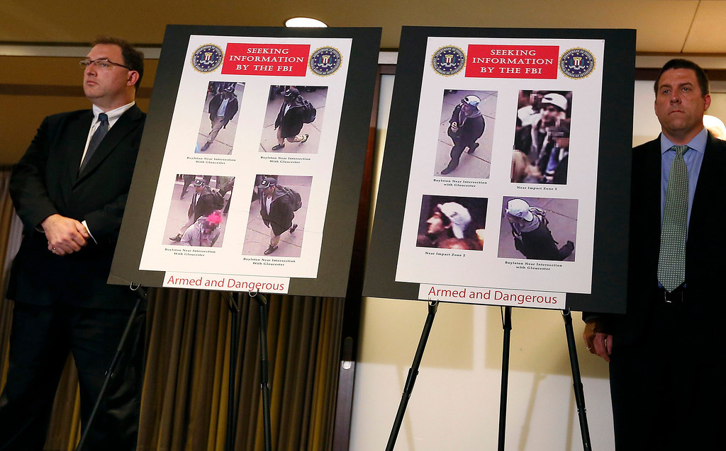 . Photos of suspects in the Boston Marathon bombings are seen during a news conference in Boston, Massachusetts April 18, 2013. The FBI said on Thursday that it has identified two suspects in the Boston Marathon bombing and is asking the public for help in identifying the two men. REUTERS/Shannon Stapleton