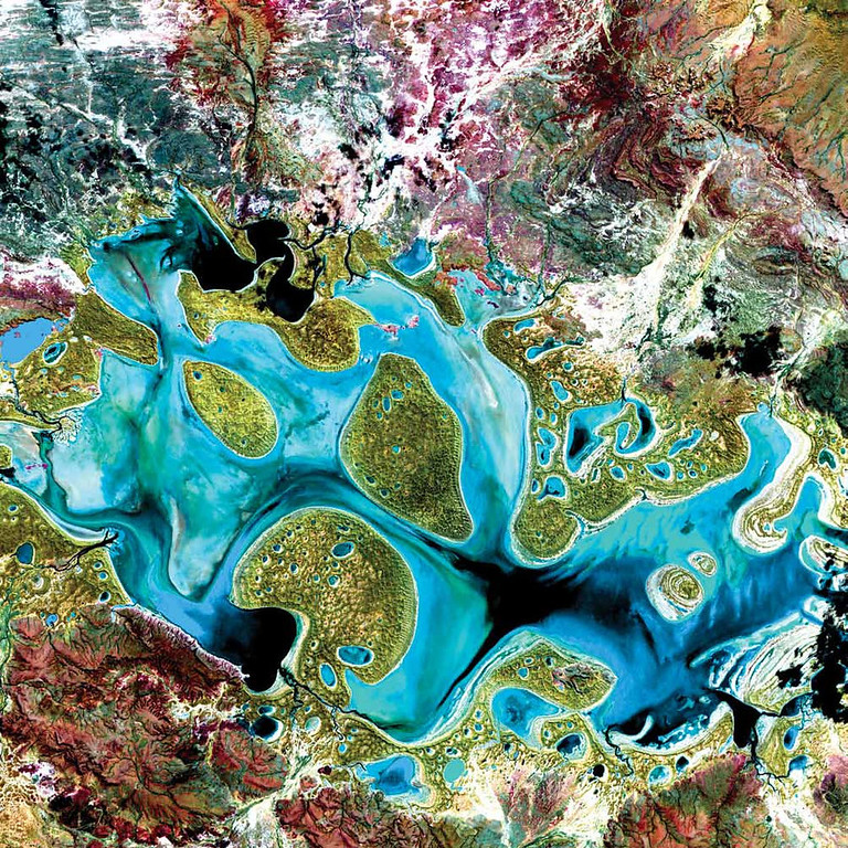. Carnegie Lake, Australia Ephemeral Carnegie Lake, in Western Australia, fills with water only during periods of significant rainfall. In dry years, it is reduced to a muddy marsh. When full, it can cover an area of about 6 square kilometers. In this Landsat 7 image from 1999, flooded areas appear dark blue or black. Vegetation appears in shades of dark and light green, and sands, soils, and minerals appear in a variety of colors.   NASA