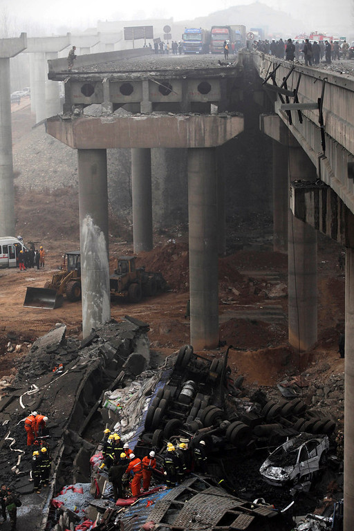 . Rescuers work at the accident site where an expressway bridge partially collapsed due to a truck explosion in Mianchi County, Sanmenxia, central China\'s Henan Province, Thursday, Feb. 1, 2013. Fireworks for Lunar New Year celebrations exploded on a truck in central China, destroying part of an elevated highway Friday and sending vehicles plummeting 30 meters (about 100 feet) to the ground. State media had conflicting reports on casualties. (AP Photo)