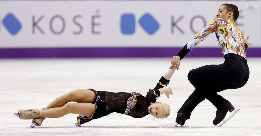 . Aliona Savchenko and Robin Szolkowy, of Germany, perform during the pairs free program at the World Figure Skating Championships Friday, March 15, 2013, in London, Ontario. (AP Photo/Darron Cummings)