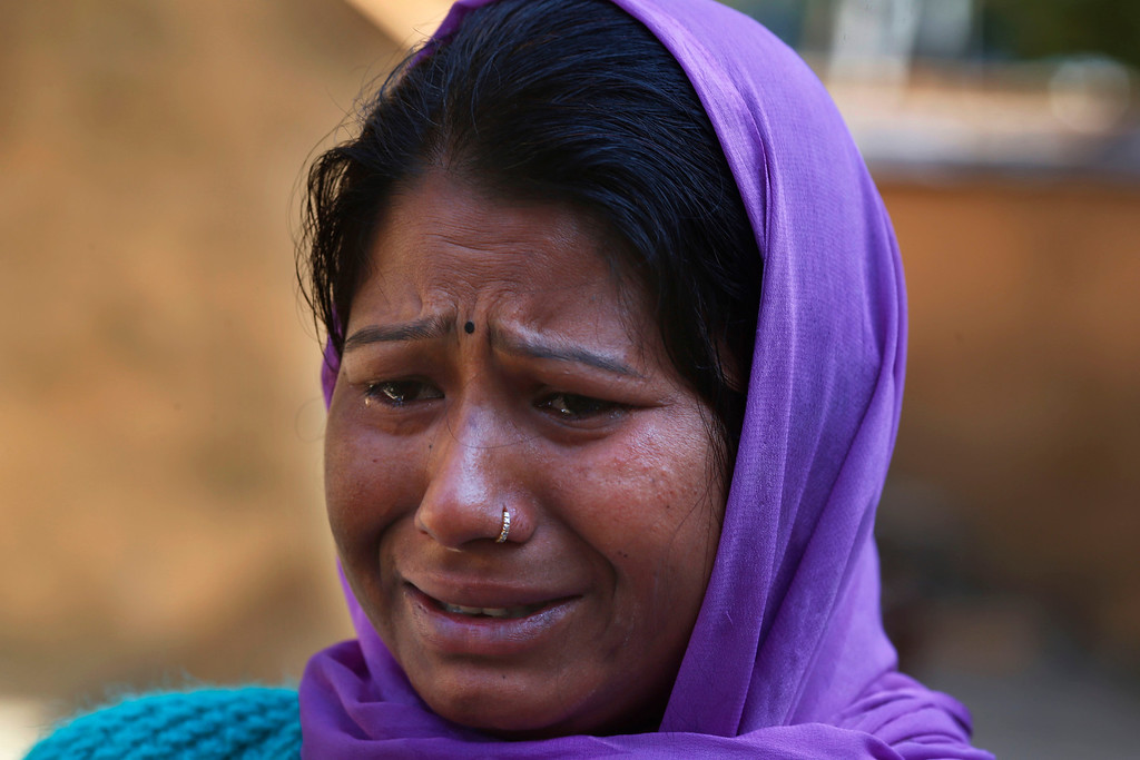 . In this Wednesday, Feb. 12, 2014 photo, Sandhya Sharma cries as she relates how her husband was killed recently by a tiger at Kalagarh, in northern India. The tiger stalking the villages of northern India has killed at least nine people so far traveling over 120 miles of villages, small towns and even a highway, spreading fear amongst the villagers many of whom are either farmers or laborers working the the large swathes of sugarcane fields which need harvesting now. (AP Photo/Saurabh Das)