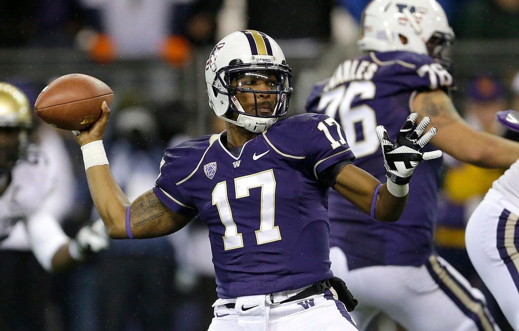 . Washington quarterback Keith Price (17) passes against Colorado in the first half of an NCAA college football game on Saturday, Nov. 9, 2013, in Seattle. (AP Photo/Ted S. Warren)