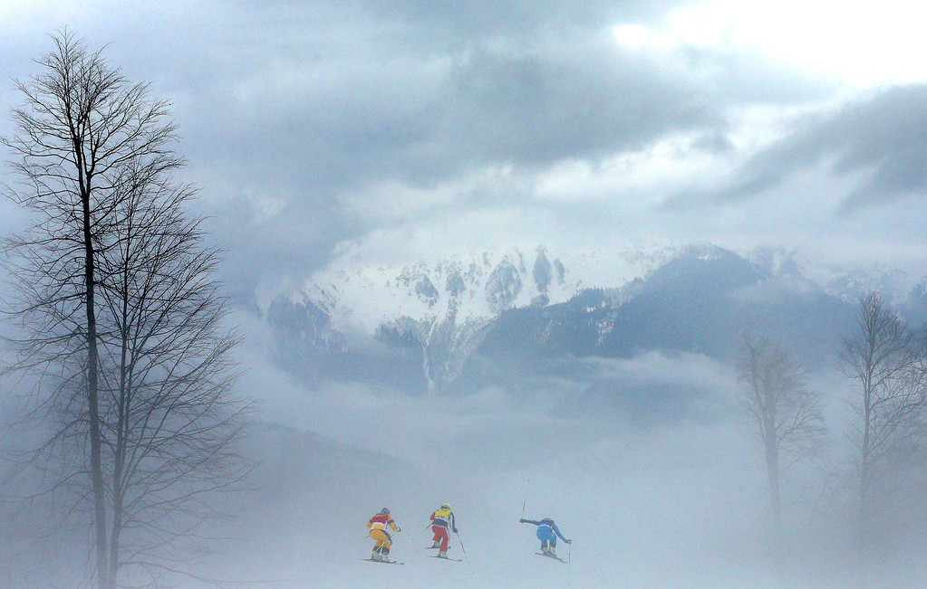 . (L-R) Anna Holmlund of Sweden, Stephanie Joffroy of Chile and Katrin Ofner of Austria compete in heavy fog in the Freestyle Skiing Womens\' Ski Cross Quarter Finals on day 14 of the 2014 Winter Olympics at Rosa Khutor Extreme Park on February 21, 2014 in Sochi, Russia.  (Photo by Cameron Spencer/Getty Images)