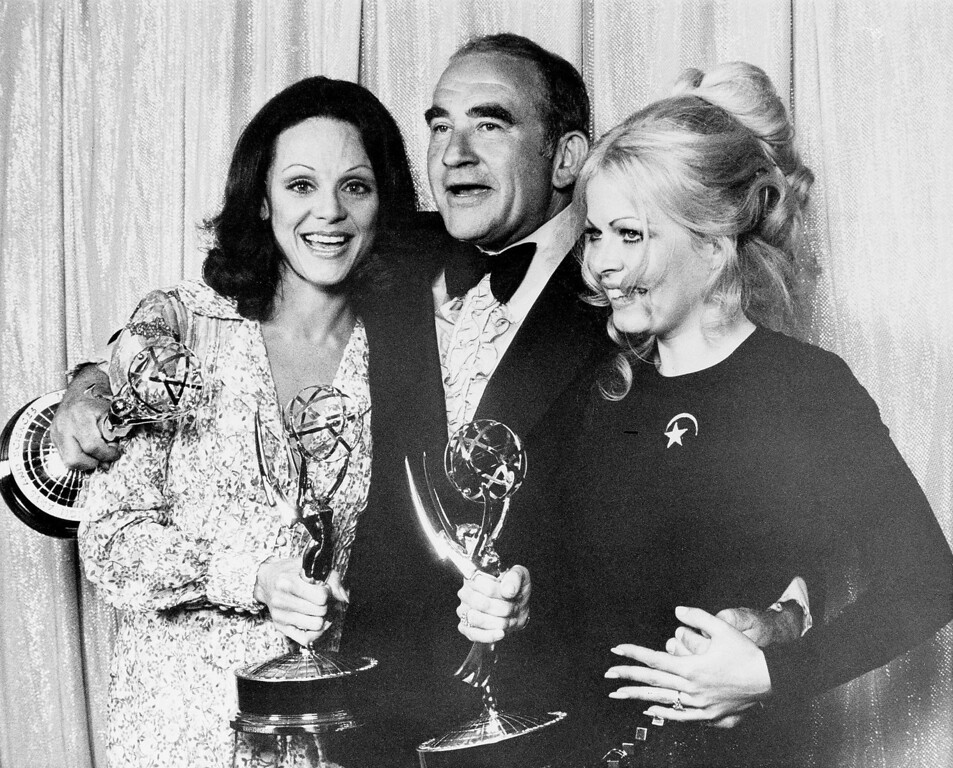 ". Valerie Harper, left, Ed Asner, center, and Sally Struthers hold their Emmys at the 24th annual Primetime Emmy Awards presentation in Hollywood, Ca., Sunday night, May 14, 1972.  Harper and Asner won best supporting actress and actor, respectively, in ""The Mary Tyler Moore Show.\""  Struthers won for her role in \""All in the Family.\""  (AP Photo)"