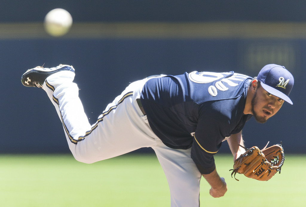 . Yovani Gallardo #29 of the Milwaukee Brewers pitches to Charlie Blackmon #19 of the Colorado Rockies at Miller Park on June 29, 2014 in Milwaukee, Wisconsin.  (Photo by Tom Lynn/Getty Images)
