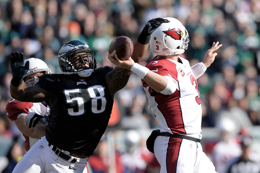 . Philadelphia Eagles\' Trent Cole (58) knocks the ball loose from Arizona Cardinals\' Carson Palmer during the first half of an NFL football game, Sunday, Dec. 1, 2013, in Philadelphia. (AP Photo/Michael Perez)
