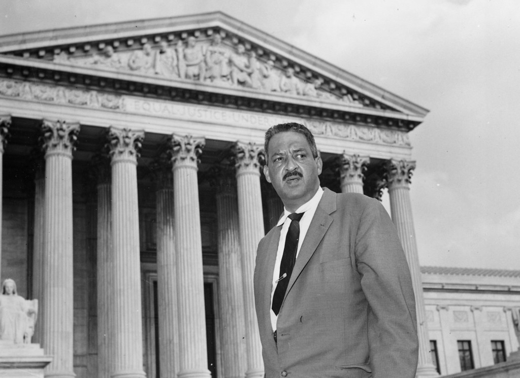 . FILE - This Aug. 22, 1958 file photo shows Thurgood Marshall outside the Supreme Court in Washington. Saturday marks the 60th anniversary of the landmark Brown v. Board of Education decision. Many inequities in education still exist for black students and for Hispanics, a population that has grown exponentially since the 1954 ruling. Marshall, the head of the NAACP\'s legal arm who argued part of the case, went on to become the Supreme Court\'s first African-American justice in 1967.  (AP Photo, File)