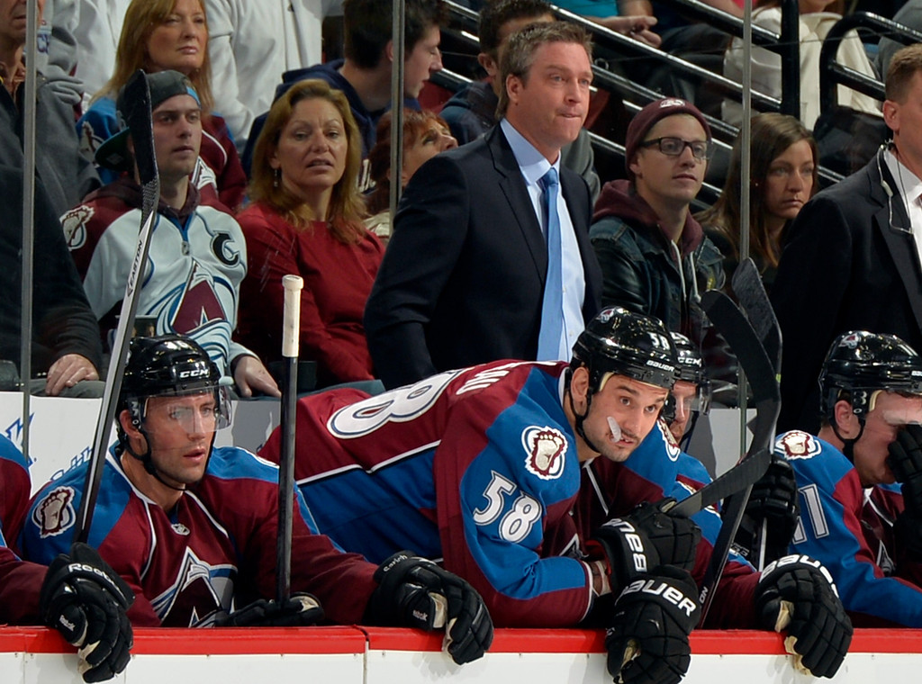 . Colorado Avalanche head coach Patrick Roy, top center, looks on with his team during the second period of an NHL hockey game against the Florida Panthers, Saturday, Nov. 16, 2013, in Denver. (AP Photo/Jack Dempsey)