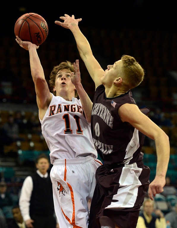 . DENVER, CO. - MARCH 9TH: Logan Jones, left, Lewis-Palmer High School, takes a shot against Christian Nehme, Cheyenne Mountain in the second half of their �Great Eight� game of the Colorado High School Basketball Championships at the Denver Coliseum, Saturday afternoon, March 9th, 2013. Lewis-Palmer won 66-49 to move on to the Final Four at the CU Events Center, March 15th, 2013. (Photo By Andy Cross/The Denver Post)