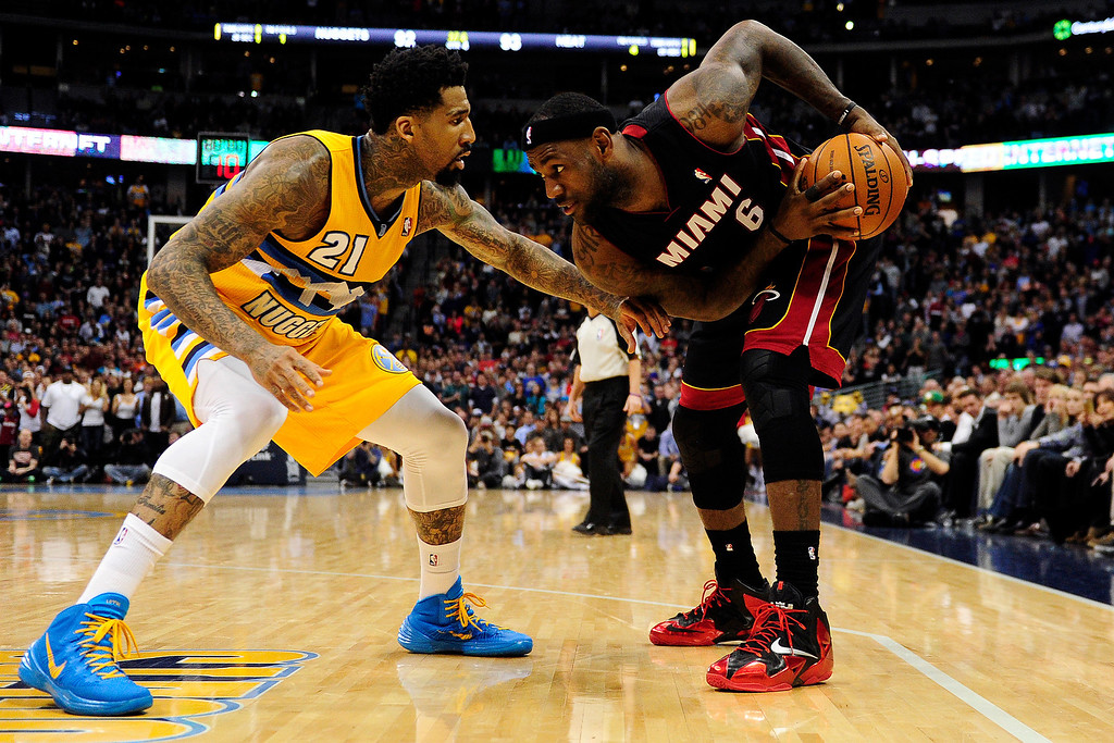 . Wilson Chandler (21) of the Denver Nuggets mans up on LeBron James (6) of the Miami Heat during the second half of Miami\'s 97-94 win.  (Photo by AAron Ontiveroz/The Denver Post)