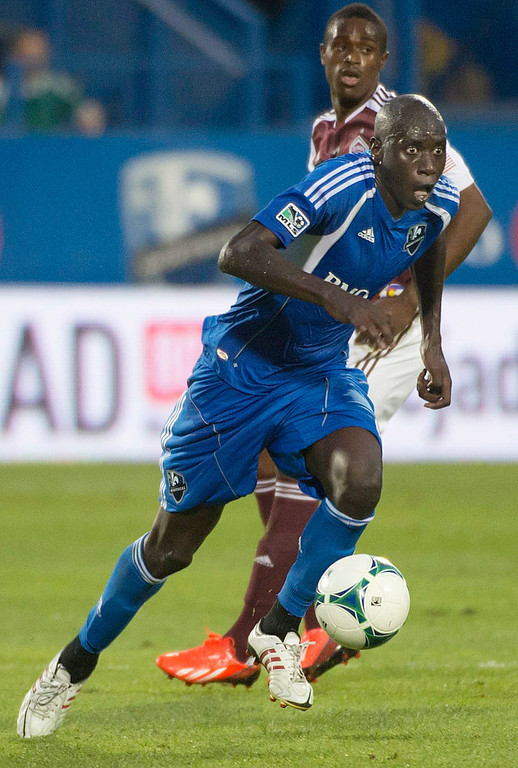 . Montreal Impact\'s Hassoun Camara breaks away with the ball during the first half of an MLS soccer game against Colorado Rapids in Montreal on Saturday, June 29, 2013. (AP Photo/The Canadian Press, Peter McCabe)