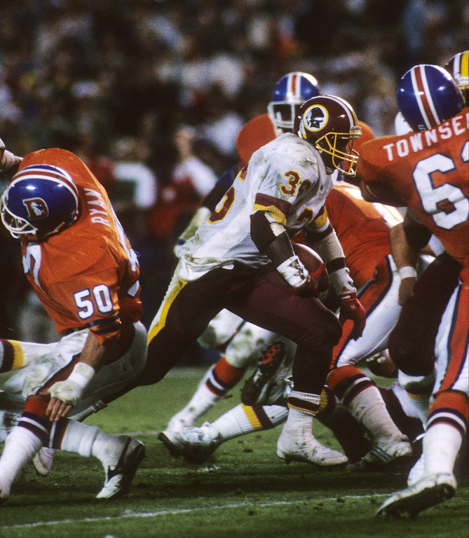 . Running back Timmy Smith #36 of the Washington Redskins runs for a touchdown under pressure from the Denver Broncos during Super Bowl XXII at Jack Murphy Stadium on January 31, 1988 in San Diego, California.    (Photo by George Rose/Getty Images)