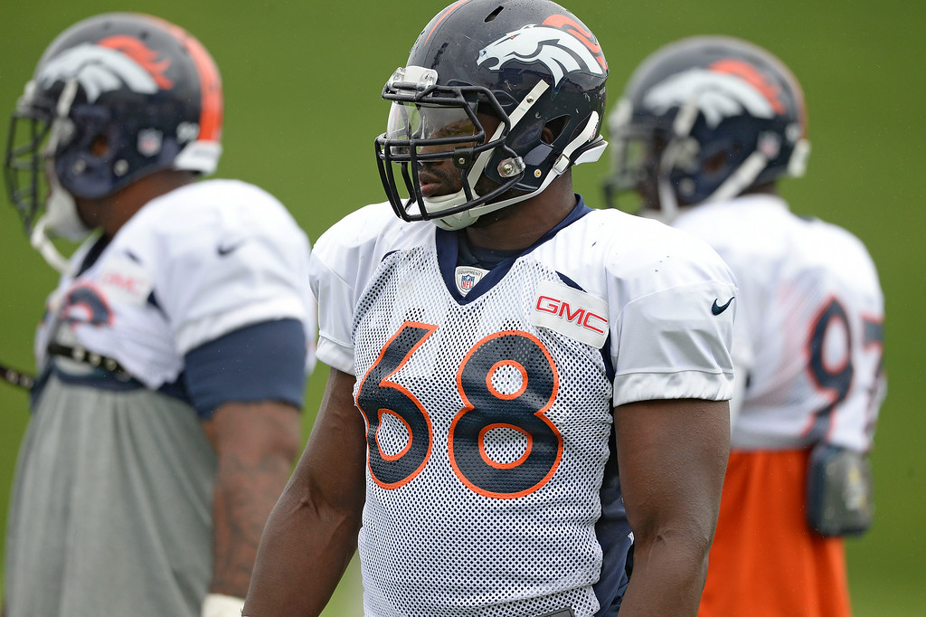 . Denver Broncos defensive end Kenny Anunike (68) looks on during day seven of the Denver Broncos 2014 training camp July 31, 2014 at Dove Valley. (Photo by John Leyba/The Denver Post)