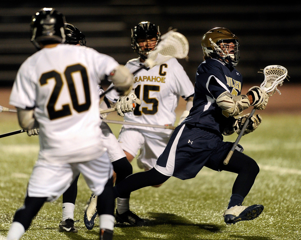 . LITTLETON, CO. - APRIL 10: Mullen senior attack Austin Smith (5) made a run with the ball in the third quarter. The Mullen High School boy\'s lacrosse team defeated Arapahoe 8-7 Wednesday night, April 10, 2013. Photo By Karl Gehring/The Denver Post)