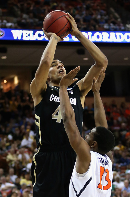 . AUSTIN, TX - MARCH 22:  Josh Scott #40 of the Colorado Buffaloes takes a shot over Tracy Abrams #13 of the Illinois Fighting Illini during the second round of the 2013 NCAA Men\'s Basketball Tournament at The Frank Erwin Center on March 22, 2013 in Austin, Texas.  (Photo by Ronald Martinez/Getty Images)