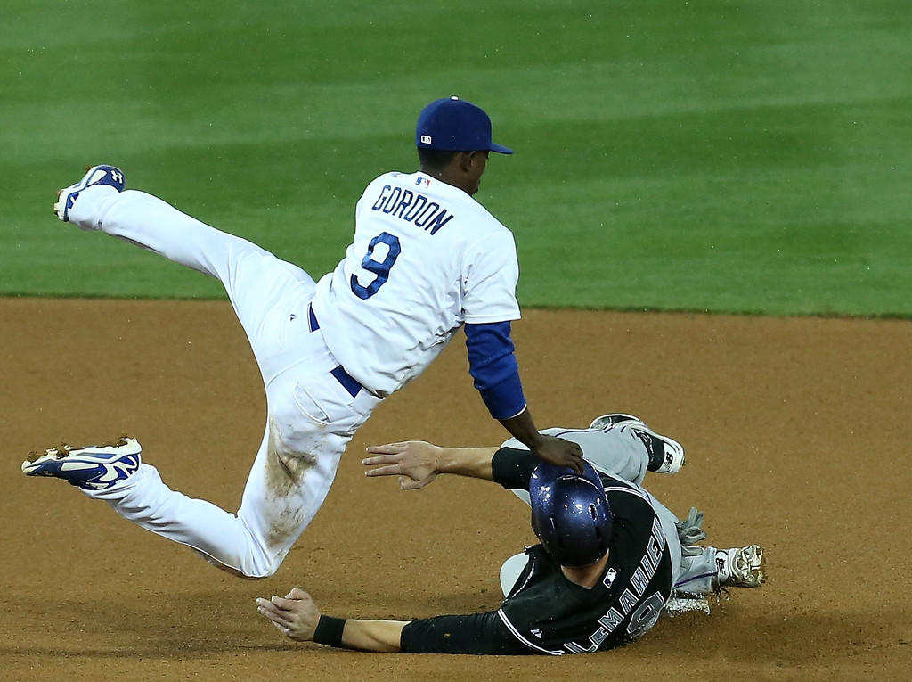 . LOS ANGELES, CA - APRIL 25: DJ Lemahieu #9 of the Colorado Rockies is safe at second with a stolen base after the ball got past second baseman Dee Gordon #9 of the Los Angeles Dodgers at Dodger Stadium on April 25, 2014 in Los Angeles, California.  (Photo by Stephen Dunn/Getty Images)
