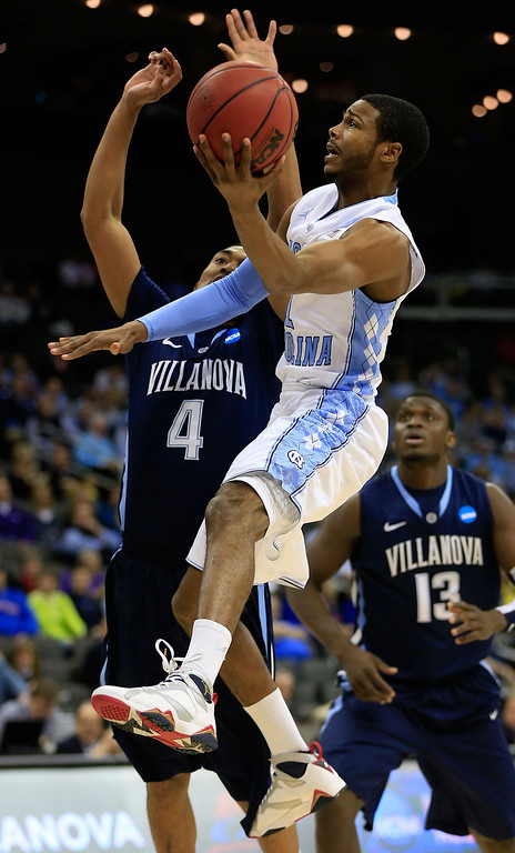 . KANSAS CITY, MO - MARCH 22: Dexter Strickland #1 of the North Carolina Tar Heels shoots against Darrun Hilliard #4 and Mouphtaou Yarou #13 of the Villanova Wildcats in the first half during the second round of the 2013 NCAA Men\'s Basketball Tournament at the Sprint Center on March 22, 2013 in Kansas City, Missouri.  (Photo by Jamie Squire/Getty Images)