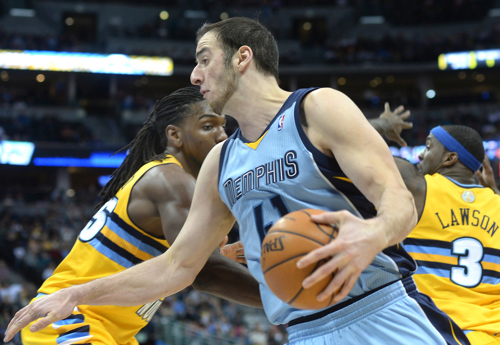 . DENVER, CO. - JANUARY 03:  Memphis center Kosta Koufos (41) put a move on Denver forward Kenneth Faried (35) in the second half. The Denver Nuggets broke an eight-game losing streak with a 111-108 win over the Memphis Grizzlies at the Pepsi Center Friday night, January 3, 2014. Photo By Karl Gehring/The Denver Post