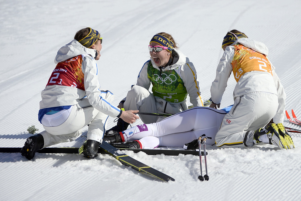 . Sweden\'s Emma Wiken (C) celebrates the Gold Medal with teammates, Ida Ingemarsdotter (L), Anna Haag (R) and Charlotte Kalla in the Women\'s Cross-Country Skiing 4x5km Relay at the Laura Cross-Country Ski and Biathlon Center during the Sochi Winter Olympics on February 15, 2014, in Rosa Khutor, near Sochi.      PIERRE-PHILIPPE MARCOU/AFP/Getty Images
