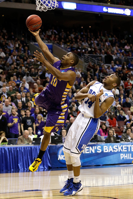 . Mike Black #10 of the Albany Great Danes goes up for a shot against Rasheed Sulaimon #14 of the Duke Blue Devils in the second half during the second round of the 2013 NCAA Men\'s Basketball Tournament on March 22, 2013 at Wells Fargo Center in Philadelphia, Pennsylvania.  (Photo by Rob Carr/Getty Images)